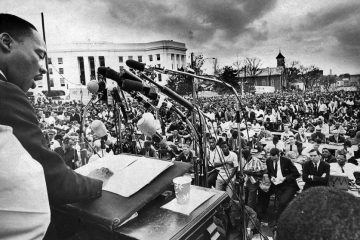 Dr. Martin Luther King Jr. addresses the crowd March 29, 1965, at the concluding event of the Selma to Montgomery march.