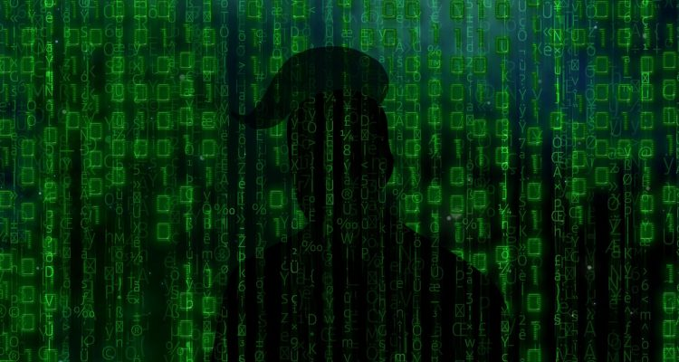 A silhouette of Trump against green streams of code