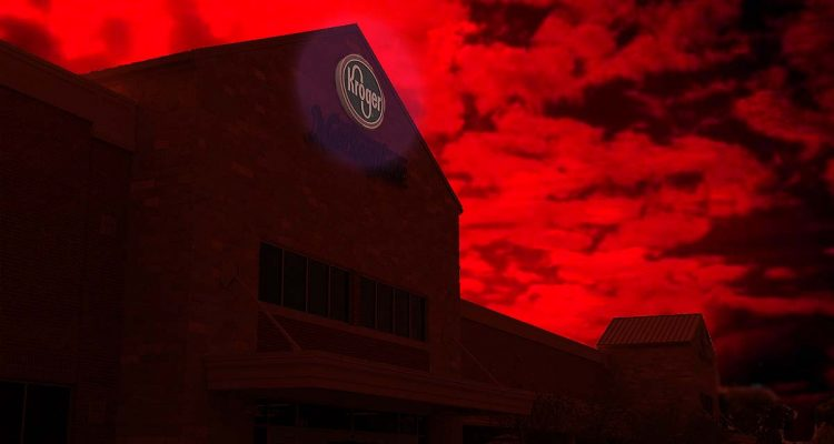 Kroger supermarket sign glows and the sky is red