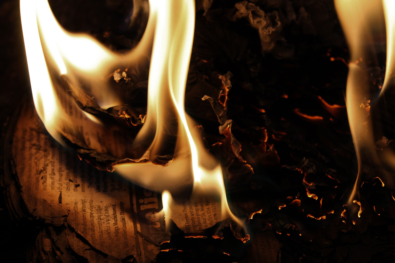 Newspapers burning